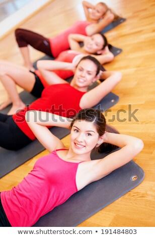 attractive woman trains yoga stock photo © meinzahn