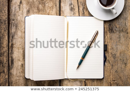 Cup of coffee with diary with fountain pen Stock photo © mizar_21984
