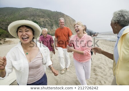 casal · praia · jogar · bola · prestados · alto - foto stock © monkey_business