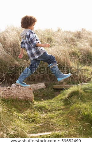 Young Boy Putting On Wellington Boots Stock photo © monkey_business