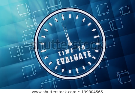 time for evaluate in clock symbol in blue glass cubes stock photo © marinini