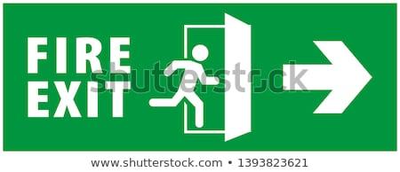 Señal de salida retro verde atrás edificio pared Foto stock © silkenphotography