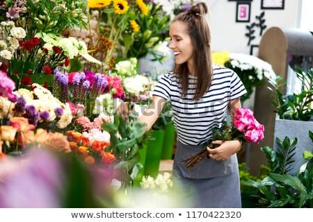 Nő virágok nevet csinos nő bent tavasz Stock fotó © feelphotoart