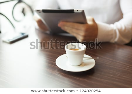 man with tablet computer and coffee reading news at motning stock photo © adamr
