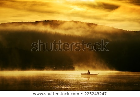 Early morning sunrise, boating on the lake in the sunlight  Stock photo © Geribody
