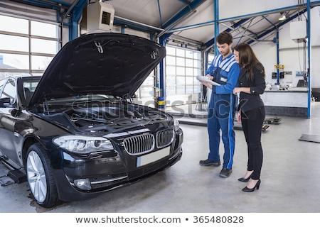 customer and car mechanic in workshop Stock photo © Kzenon