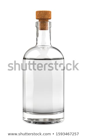 Liquor bottle and drinking glass filled with clear liquid Stock photo © Zerbor