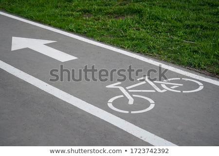 Bicycle lane or path, icon symbol on asphalt road Stock photo © FrameAngel