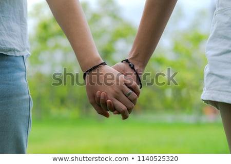 Közelkép boldog leszbikus pár kéz a kézben emberek Stock fotó © dolgachov