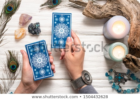 Femme tarot cartes bleu robe Photo stock © courtyardpix