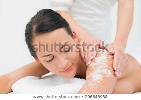 bella · sorridere · bruna · massaggio · tavola · sale - foto d'archivio © wavebreak_media