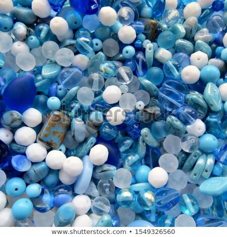 Beautiful glass beads closeup on white background Stock photo © Nneirda