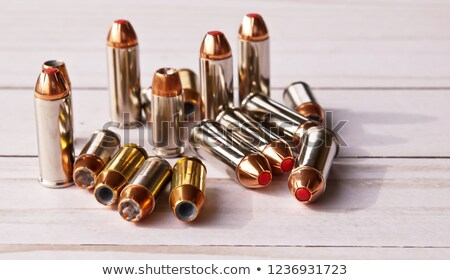 one cartridge with copper bullet and lead tip stock photo © bezikus