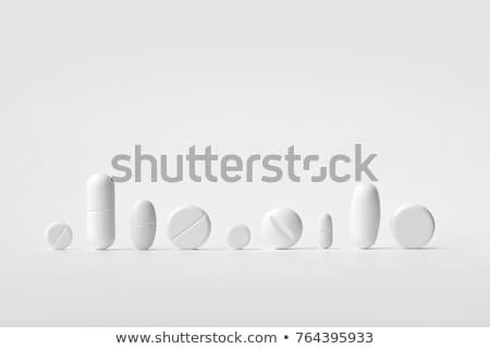Tabletták izolált fehér gyógyszer kék csomag Stock fotó © tetkoren