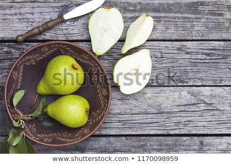Armut plaka ahşap ahşap meyve arka plan Stok fotoğraf © OleksandrO