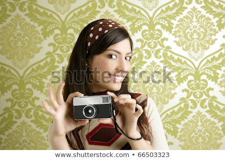 Retro photo camera woman green sixties wallpaper Stock photo © lunamarina