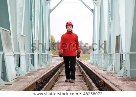Man worker blindly in a helmet stands on the rails bridge Stock photo © Paha_L