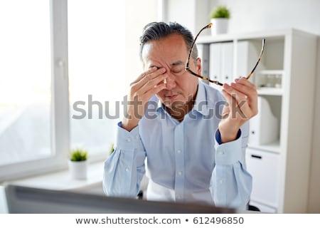 Fatigué épuisé asian Homme travail portable Photo stock © deandrobot