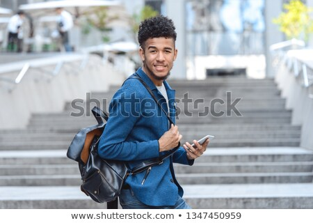 Positive male with beard walking and looking camera Stock photo © deandrobot