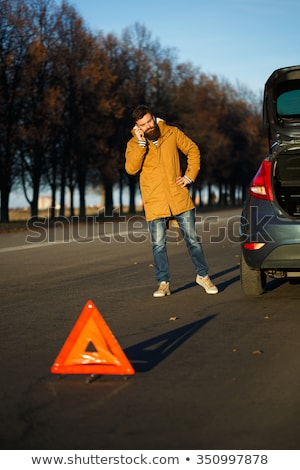 Stock photo: Man examining damaged automobile cars after breaking