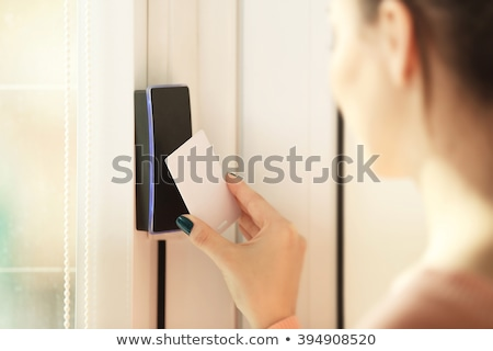Human Hand With Security System And Remote Stock photo © AndreyPopov