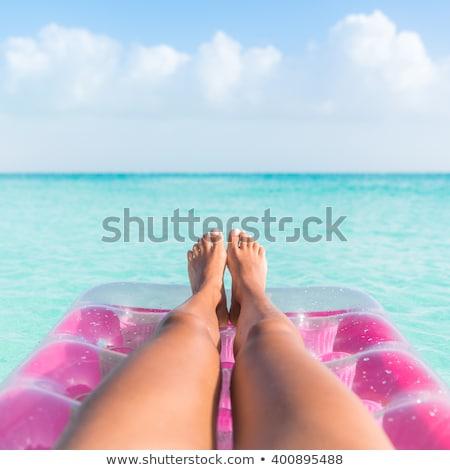 Beach relaxation on floating ocean water mattress Stock photo © Maridav