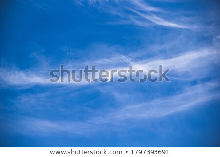 Moon Visible In Blue Sky With White Soft Clouds Stock photo © radub85