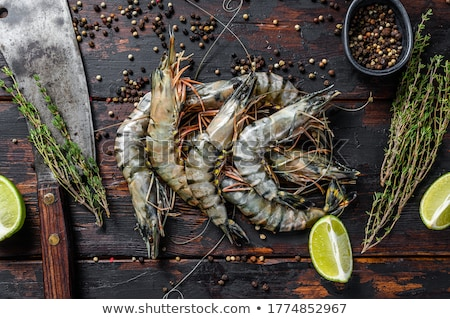 Raw black tiger prawns with spices Stock photo © andreasberheide
