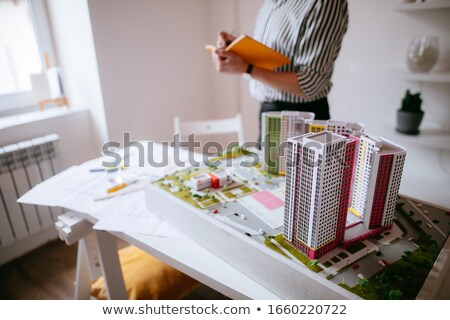 An engineer with a sketch plan standing in front of the building Stock photo © bluering