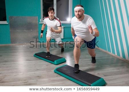 Kövér férfi edzés szívritmus monitor boldog munka Stock fotó © pedromonteiro