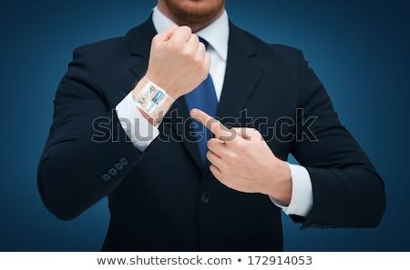 üzletember · mutat · okos · óra · kéz · üzletemberek - stock fotó © dolgachov