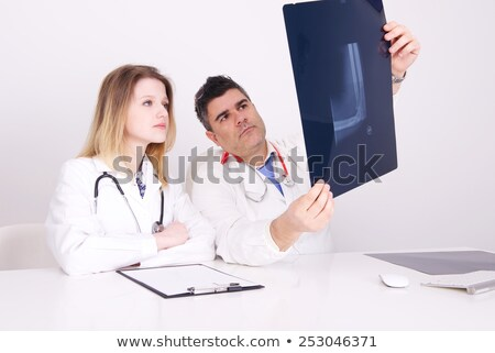 female doctor examining pelvis x ray in hospital office stock photo © stevanovicigor