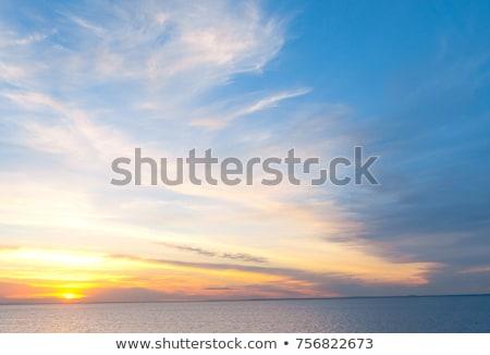 Grande poderoso pôr do sol nuvens verão água Foto stock © digoarpi