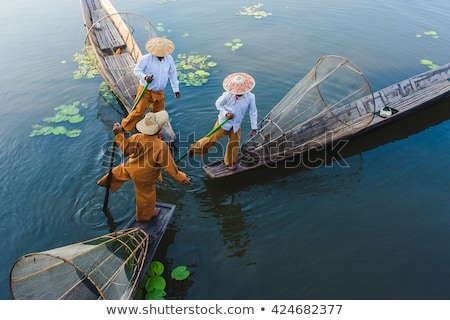 Fisherman silhouette with net at Inle lake Stock photo © Mikko