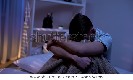 boy in bed crying stock photo © derocz