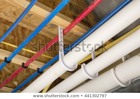 PEX pipes on basement ceiling stock photo © icemanj
