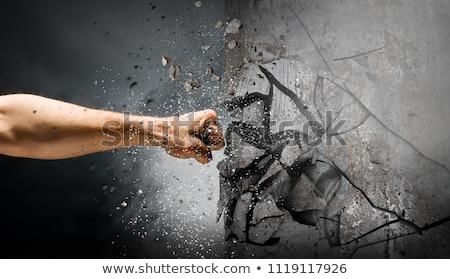 Breaking wall. mixed media Stock photo © alphaspirit