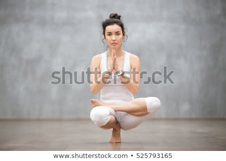 Woman practicing yoga with strap  Stock photo © LightFieldStudios