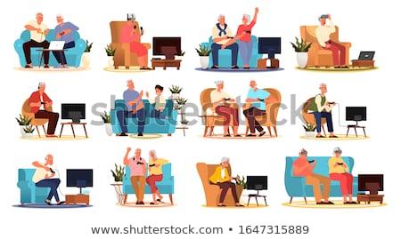 Сток-фото: женщину · играет · видеоигра · кавказский · сидят · диван