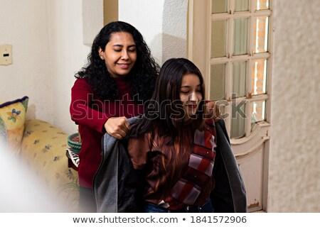 Vrouw Rood jas lopen hal mooie Stockfoto © deandrobot