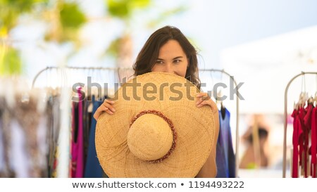 Woman in beachwear hiding behind the hat Stock photo © deandrobot