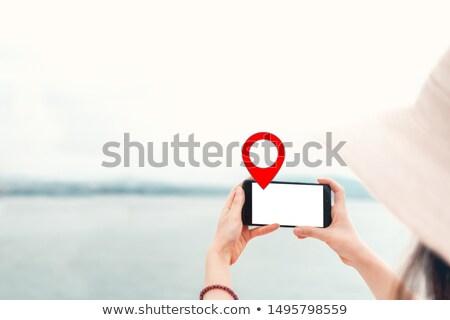 Woman holding guiding direction arrow sign Stock photo © stevanovicigor