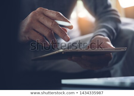 hands using smart home application on tablet pc stock photo © wavebreak_media