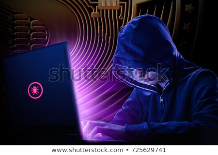 Arrested computer hacker with handcuffs wearing hooded jacket Stock photo © stevanovicigor