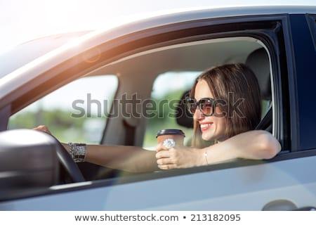 ストックフォト: Woman With Coffee To Go Driving Her Car