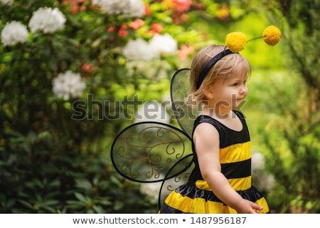 Cute girl wearing a Halloween bee costume Stock photo © zooco