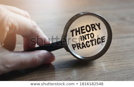 learn theory through magnifying glass stock photo © tashatuvango