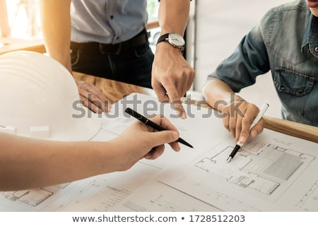 architects engineer discussing at the table with blueprint   clo stock photo © snowing