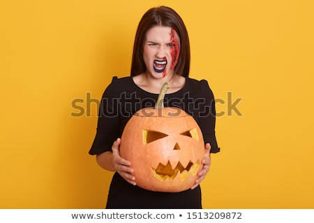 Sikít fiatal nő boszorkány halloween jelmez fotó Stock fotó © deandrobot