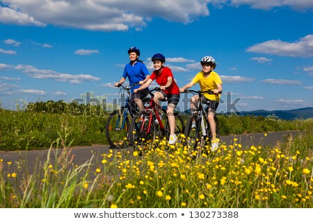 Girl on bike on country lane Stock photo © IS2